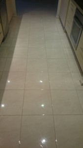 this photo shows the same tiled floor after we cleaned it with our high powered extraction unit